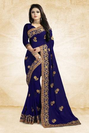 Add This Beautiful Designer Saree To Your Wardrobe In Navy Blue Color Paired With Navy Blue Colored Blouse. This Pretty Embroidered Saree Is Georgette Based Paired With Art Silk Fabricated Blouse. It Is Light Weight and Easy To Drape. Buy Now.