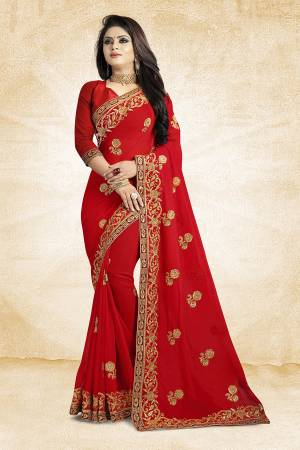 Add This Beautiful Designer Saree To Your Wardrobe In Red Color Paired With Red Colored Blouse. This Pretty Embroidered Saree Is Georgette Based Paired With Art Silk Fabricated Blouse. It Is Light Weight and Easy To Drape. Buy Now.