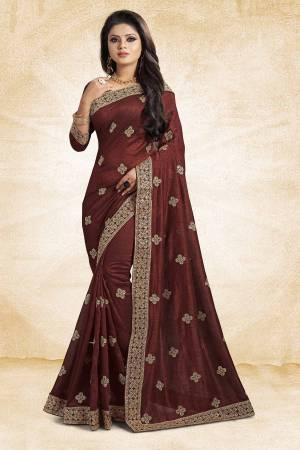 For Rich, Heavy And Elegant Look, This Saree Is Suitable For All.?Grab This Designer Saree In Brown Color Paired With Brown Colored Blouse. This Saree And Blouse Are Silk Based Beautified With Embroidered Buttis And Lace Border. Buy Now