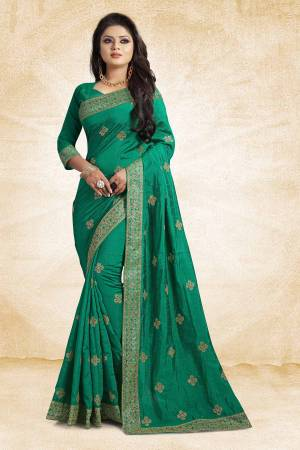 This Festive Season, Grab This Designer Saree In Sea Green Color Paired?With Sea Green Colored Blouse. This Saree And Blouse Are Silk Based Beautified With heavy Attractive Embroidery