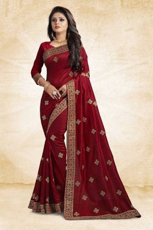 Look Pretty In This Lovely Designer Saree In Maroon Color Paired With Maroon Colored Blouse. This Pretty Embroidered Saree In Fabricated On Vichitra Silk Paired With Art Silk Fabricated Blouse. It Has Jari Embroidery With Stone Work Giving The Saree An Attractive Look.