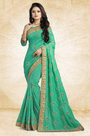 For Rich, Heavy And Elegant Look, This Saree Is Suitable For All.?Grab This Designer Saree In Sea Green Color Paired With Sea Green Colored Blouse. This Saree And Blouse Are Silk Based Beautified With Embroidered Buttis And Lace Border. Buy Now