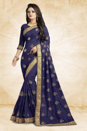 Look Pretty In This Lovely Designer Saree In Navy Blue Color Paired With Navy Blue Colored Blouse. This Pretty Embroidered Saree In Fabricated On Vichitra Silk Paired With Art Silk Fabricated Blouse. It Has Jari Embroidery With Stone Work Giving The Saree An Attractive Look.