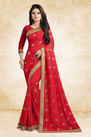 Look Pretty In This Lovely Designer Saree In Red Color Paired With Red Colored Blouse. This Pretty Embroidered Saree In Fabricated On Vichitra Silk Paired With Art Silk Fabricated Blouse. It Has Jari Embroidery With Stone Work Giving The Saree An Attractive Look.