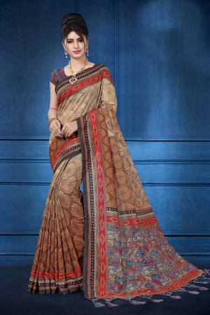 Add This Pretty Saree For your Semi-Casual Wear With Digital Prints All Over. This Saree And Blouse Are Fabricated On Art Silk Which Ensures Superb Comfort All Day Long.