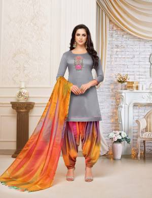 Rich And Elegant Looking Patiala Suit In Grey Colored Top Paired With Multi Colored Bottom And Dupatta. This Dress Material Is Fabricated On Soft Silk Beautified With Hand Work Over The Top. Buy Now.