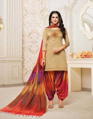 Stylist in every sense, this Beige colored patiala suit with beautiful  handwork. Crafted from soft silk with banarasi dupatta fabric, it is light in weight and will be soft against your skin, this suit set will go well with sandal sand look fashionable.
