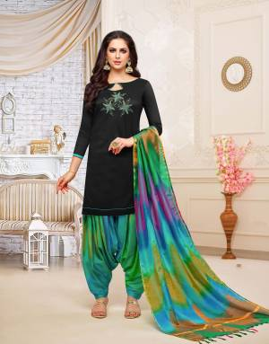 Rich And Elegant Looking Patiala Suit In Black Colored Top Paired With Multi Colored Bottom And Dupatta. This Dress Material Is Fabricated On Soft Silk Beautified With Hand Work Over The Top. Buy Now.