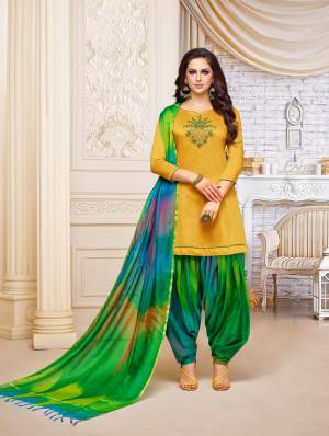 Enhance Your Personality Wearing This Designer Patiala Suit In Musturd Yellow Colored Top Paired With Green Colored Bottom And Dupatta. This Dress Material Is Fabricated On Soft Silk, Get This Stitched As Per Your Desired Fit And Comfort.