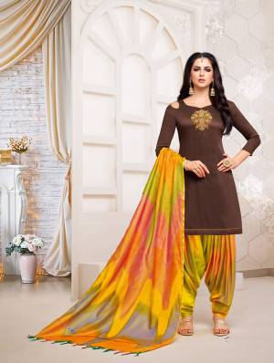Stylist in every sense, this Brown colored patiala suit with beautiful  handwork. Crafted from soft silk with banarasi dupatta fabric, it is light in weight and will be soft against your skin, this suit set will go well with sandal sand look fashionable.