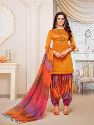 For A Royal Attractive Look, Grab This Designer Patiala Suit In Orange Colored Top Paired With Contrasting Multi Colored Bottom And Dupatta. This Dress Material Is Fabricated On Soft Silk Beautified With Hand Work Over The Top. It IS Light Weight And Easy To Carry All Day Long.