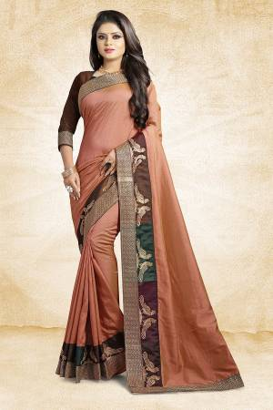 Rich And Elegant Looking Designer Silk Based Saree Is Here In Beige Color Paired With Brown Colored Blouse. This Saree And Blouse are Fabricated On Art Silk Beautified With Emroidered Lace. Buy Now.