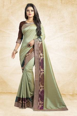 Rich And Elegant Looking Designer Silk Based Saree Is Here In Pastel Green Color Paired With Brown Colored Blouse. This Saree And Blouse are Fabricated On Art Silk Beautified With Emroidered Lace. Buy Now.
