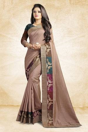 Rich And Elegant Looking Designer Silk Based Saree Is Here In Mauve Color Paired With Brown Colored Blouse. This Saree And Blouse are Fabricated On Art Silk Beautified With Emroidered Lace. Buy Now.