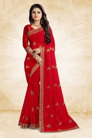 This Festive Season, Look Elegant With This Light Weight Saree In Red Color Paired With Red Colored Blouse. This Saree Is Fabricated On Georgette Paired With Art Silk Fabricated Blouse. It Is Beautified With Embroidered Butti And Lace Border.
