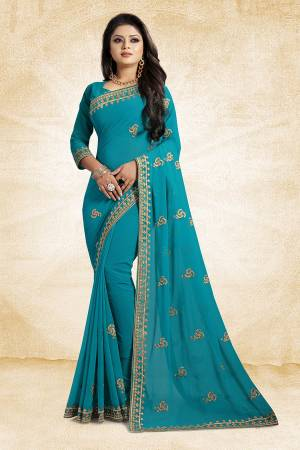 This Festive Season, Look Elegant With This Light Weight Saree In Blue Color Paired With Blue Colored Blouse. This Saree Is Fabricated On Georgette Paired With Art Silk Fabricated Blouse. It Is Beautified With Embroidered Butti And Lace Border.