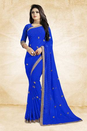 This Festive Season, Look Elegant With This Light Weight Saree In Royal Blue Color Paired With Royal Blue Colored Blouse. This Saree Is Fabricated On Georgette Paired With Art Silk Fabricated Blouse. It Is Beautified With Embroidered Butti And Lace Border.