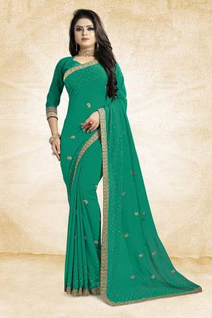 This Festive Season, Look Elegant With This Light Weight Saree In Sea Green Color Paired With Sea Green Colored Blouse. This Saree Is Fabricated On Georgette Paired With Art Silk Fabricated Blouse. It Is Beautified With Embroidered Butti And Lace Border.