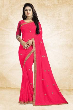 This Festive Season, Look Elegant With This Light Weight Saree In Fuschia Pink Color Paired With Fuschia Pink Colored Blouse. This Saree Is Fabricated On Georgette Paired With Art Silk Fabricated Blouse. It Is Beautified With Embroidered Butti And Lace Border.