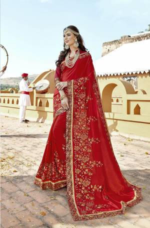 Adorn the Pretty Angelic Look Wearing This Designer Saree In Red Color Paired With Red Colored Blouse. This Saree And Blouse Are Silk Based Beautified With Heavy Work.
