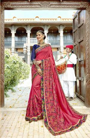 Shine Bright Wearing This Designer Saree In dark Pink Color Paired With Contrasting Royal Blue Colored Blouse. This Saree And Blouse Are Silk Based Beautified With Heavy Embroidery All Over.