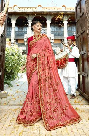 Look Pretty In This Designer Pink Colored Saree Paired With Dark Pink Colored Blouse. This Saree And Blouse are Silk Based Beautified With Heavy Embroidery Giving It An Attractive Look .