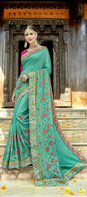 Beat The Heat This Summer With Bright Colors At the Next Function. Grab This Designer Saree In Sea Green Color Paired With Contrasting Rani Pink Colored Blouse. This Saree And Blouse Are Silk Based Beautified With Heavy Embroidery All Over.