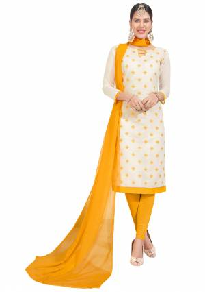 Rich And Elegant looking Dress Material Is Here In Chanderi Silk Fabricated Top Paired With Cotton Bottom And Chiffon Dupatta. Get This Stitched As Per Your Desired Fit And Comfort. Its Rich Color Pallete Of White And Yellow Will Also Earn You Lots Of Compliments From Onlookers.