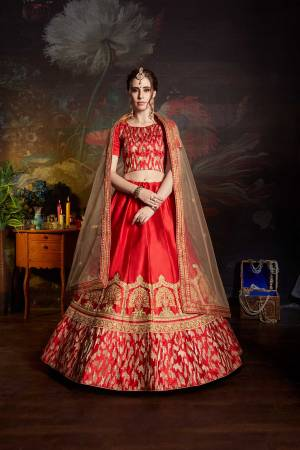Get Ready For The Upcoming Wedding Season With This Designer Heavy Lehenga Choli In Red color Paired With Beige Colored Dupatta. Its Blouse And Lehenga Are Fabricated On Satin Paired With Net Fabricated Dupatta. It Has Pretty Attractive Embroidery All Over It.