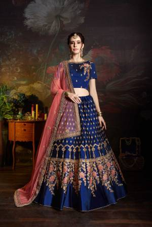 Bright And Visually Appealing Color Is Here With This Heavy Deisgner Lehenga Choli In Royal Blue Color Paired With Contrasting Pink Colored Dupatta. Its Blouse And Lehenga Are Satin Based Paired With Net Fabricated Dupatta. Buy This Lehenga Choli Now.