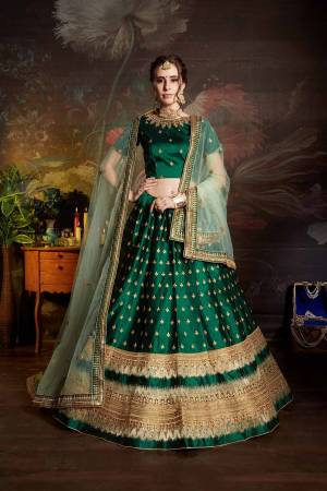 Catch All The Limelight Wearing This Heavy Designer Lehenga Choli In Dark Green Color Paired With Light Green Colored Dupatta. This Lehenga Choli Is Fabricated On Satin Beautified With Heavy Embroidery Paired With Net Based Dupatta. Buy Now.