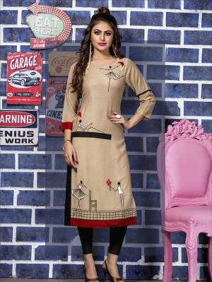 Here Is Pretty Kurti In Beige Color For Your Semi-Casual Wear. This Kurti Is Fabricated Rayon Beautified With Thread Work. It Is Available In All Regular Sizes.