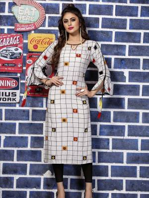 Grab This Designer Readymade Kurti In White Color Fabricated On Rayon. This Kurti Is Beautified With Thread Work And Prints. Its Fabric Ensures Superb Comfort All Day Long.