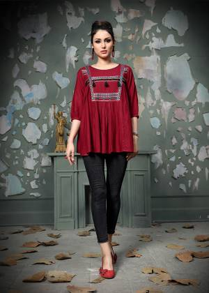Add This Pretty Designer Readymade Top To your Wardrobe In Maroon Color.This Pretty Cotton Based Top Is Beautified With Multi Colored Thread Work And Avialable In All Regular Sizes.
