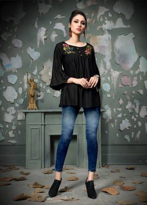 Add This Pretty Designer Readymade Top To your Wardrobe In Black Color.This Pretty Cotton Based Top Is Beautified With Multi Colored Thread Work And Avialable In All Regular Sizes.
