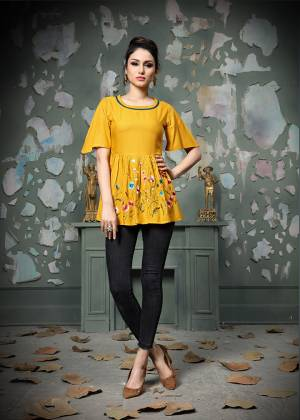 Add This Pretty Designer Readymade Top To your Wardrobe In Yellow Color.This Pretty Cotton Based Top Is Beautified With Multi Colored Thread Work And Avialable In All Regular Sizes.