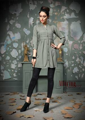 Add This Pretty Designer Readymade Top To your Wardrobe In Grey Color.This Pretty Cotton Based Top Is Beautified With Multi Colored Thread Work And Avialable In All Regular Sizes.