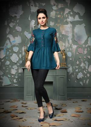 Add This Pretty Designer Readymade Top To your Wardrobe In Blue Color.This Pretty Cotton Based Top Is Beautified With Multi Colored Thread Work And Avialable In All Regular Sizes.