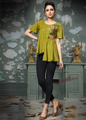 Add This Pretty Designer Readymade Top To your Wardrobe In Pear Green Color.This Pretty Cotton Based Top Is Beautified With Multi Colored Thread Work And Avialable In All Regular Sizes.