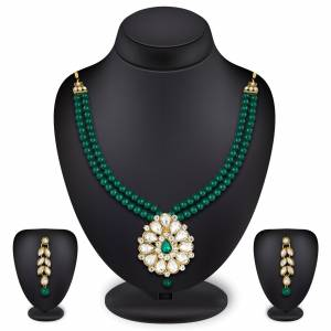 Grab This Very Pretty Pearl Necklace Set In Green Color Beautified With Stone Work. You Can Pair This Up With Same Or Any Contrasting Colored Traditional Attire. Buy Now.