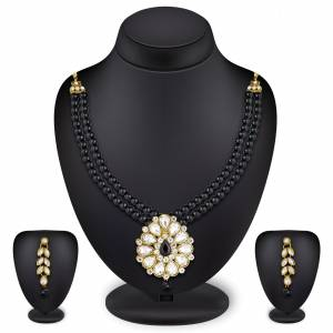 Grab This Very Pretty Pearl Necklace Set In Black Color Beautified With Stone Work. You Can Pair This Up With Same Or Any Contrasting Colored Traditional Attire. Buy Now.