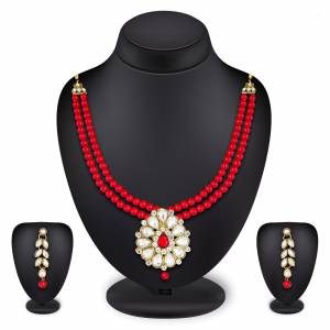 Grab This Very Pretty Pearl Necklace Set In Red Color Beautified With Stone Work. You Can Pair This Up With Same Or Any Contrasting Colored Traditional Attire. Buy Now.