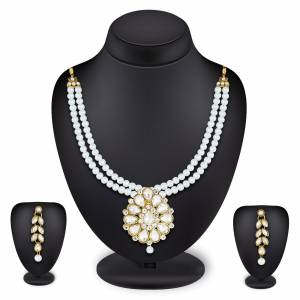 Grab This Very Pretty Pearl Necklace Set In White Color Beautified With Stone Work. You Can Pair This Up With Same Or Any Contrasting Colored Traditional Attire. Buy Now.