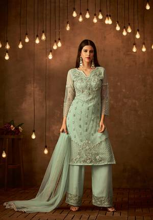 This Season Is About Subtle Shades And Pastel Play, So Grab This Designer Semi-Stitched Suit In Pastel Green Color Paired With Pastel Green Colored Bottom And Dupatta. Its Top Is Fabricated On Heavy Embroidered Net Paired With Satin raw Silk Bottom And Net Fabricated Dupatta. Buy Now.