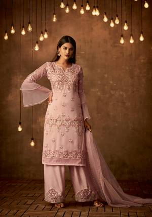 Look Pretty Wearing This Designer Straight Suit In Baby Pink color Paired With Baby Pink Colored Bottom And Dupatta, Its Top And Dupatta Are Net Fabricated Paired With Satin Silk Bottom. Its Fabrics Also Ensures Superb Comfort All Day Long.