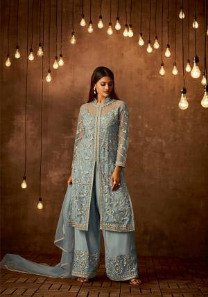 Celebrate This Festive Season With Ease And Comfort Wearing This Designer Straight Suit In Light Blue Color Paired With Light Blue Colored Bottom And Dupatta. Its Top And Dupatta Are Net Fabricated Paired With Satin Raw Silk Bottom. It Is Light In Weight And Easy To Carry all Day Long.