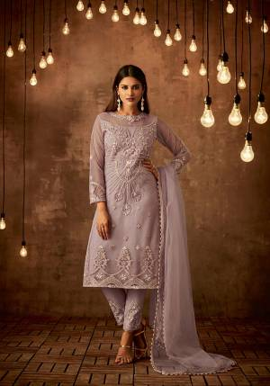New And Pretty Shade Is Here With This Designer Straight Suit In Lilac Color Paired With Lilac Colored Bottom And Dupatta, Which Is Hue Of Purple. This Semi-Stitched Suit Is Fabricated On Net Paired With Satin Raw Silk Bottom And Net Fabricated Dupatta. Buy This Now.