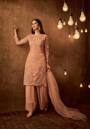 Here Is A Very Pretty Attractive Designer Straight Suit In Peach Color Paired With Peach Colored Bottom And Dupatta. Its Top Is Fabricated On Net Paired With Satin Raw Silk Bottom And Net Fabricated Dupatta. All Its Fabric Are Light Weight And Easy To Carry All Day Long. Buy Now.