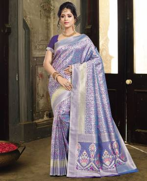 If You Have An Eye For Intricate Designs, Than Grab This Designer Silk Based Saree. This Saree And Blouse Are Fabricated On Art Silk Beautified With Intricate Weave All Over It. It Is Durable And Easy To Care For.