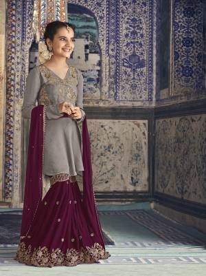 Grab This Beautiful Sharara Suit for You And Your Daughter In Grey Colored Top Paired With Dark Pink Colored Bottom And Dupatta. Its Top And Bottom Are Fabricated On Georgette Paired With Chiffon Fabricated Dupatta.